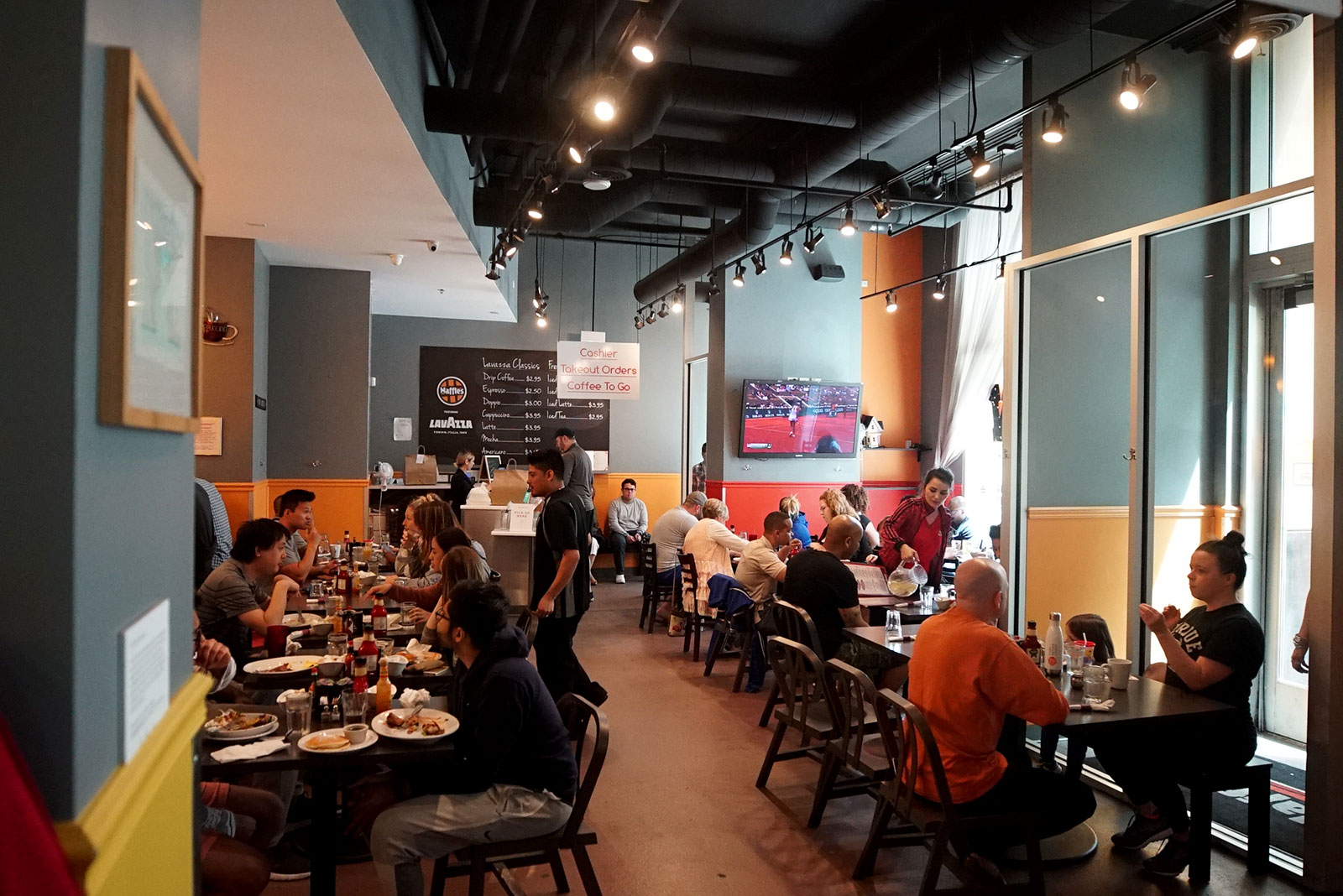 Diners inside of the Chicago Waffles South Loop location