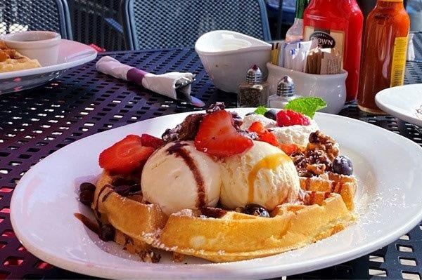 plate with waffles, ice creamand strawberries